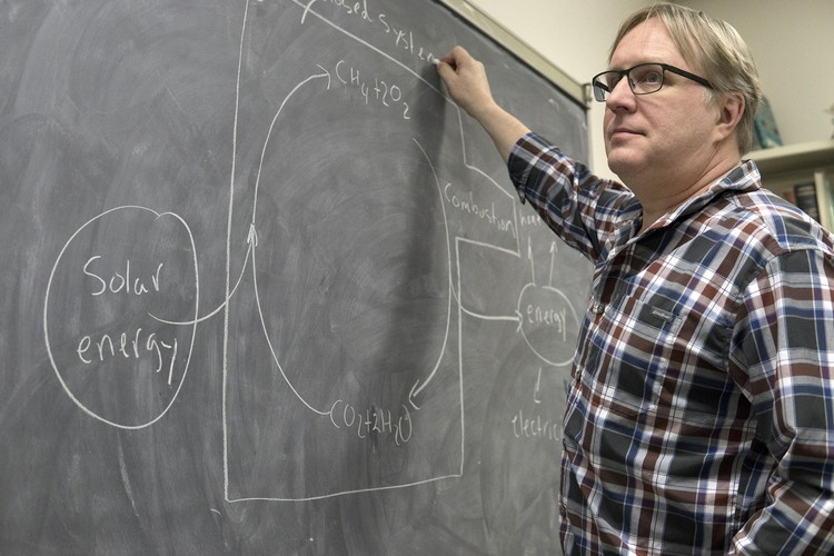 Steve Bergens sketches out the process on his office chalkboard.